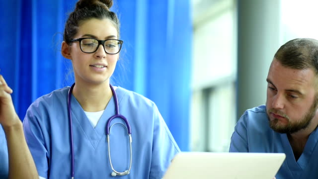 medical team meeting - nurse stock videos and b-roll footage