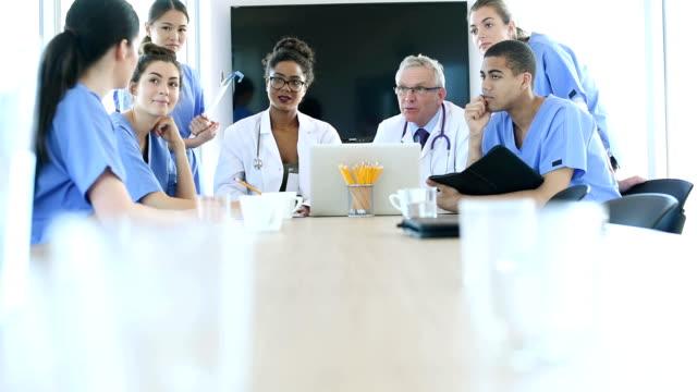medical team meeting . video