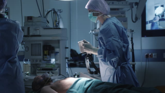 Medical Team Performing Defibrillation in Modern Operating Room video