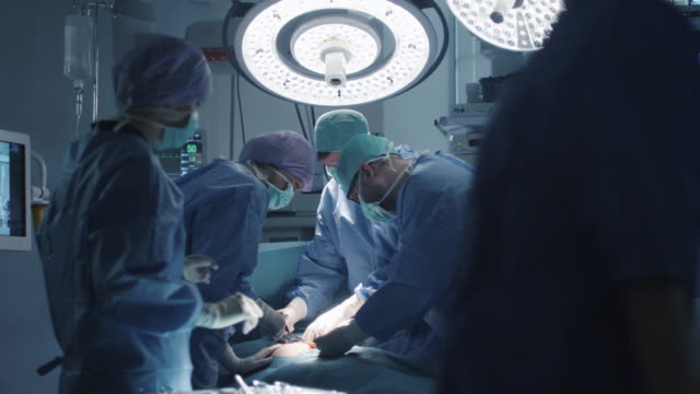 Medical Team Performing Surgical Operation in Modern Operating Room Medical Team Performing Surgical Operation in Modern Operating Room operating stock videos & royalty-free footage