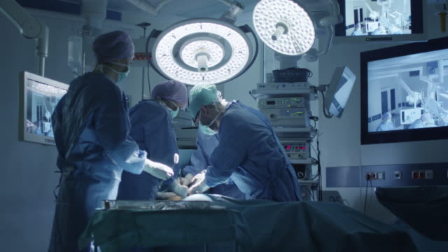 Medical Team Performing Surgical Operation in Modern Operating Room video