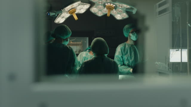 Medical team performing surgical operation