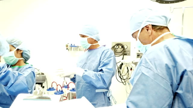 Medical team prepares patient for surgery in operating room video
