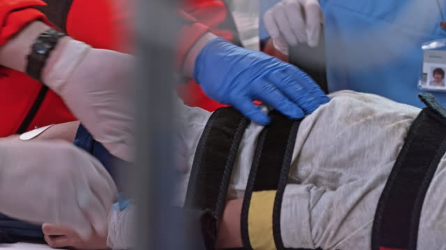 Medical team unstrapping a child patient on a spinal board video