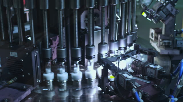 Medical vials on pharmaceutical manufacturing line. Pharmaceutical industry video