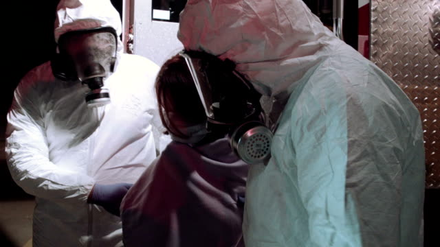 Medical Workers Helping Ebola Patient video