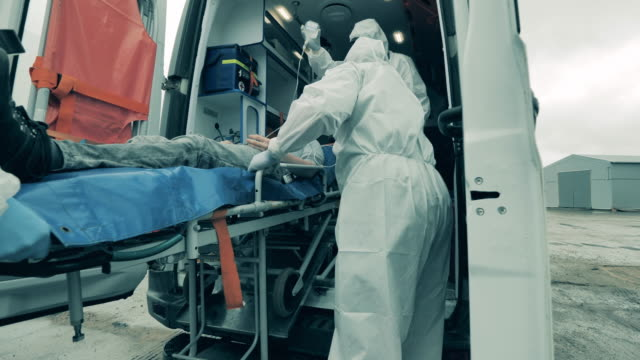 Medical workers transport patient on stretcher. video