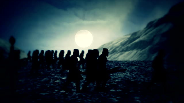 medieval army marching at a full moon night close to a mountain range - битва стоковые видео и кадры b-roll