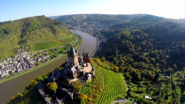 Medieval castle aerial, German village Cochem European vine hill. Beautiful aerial shot above Europe, culture and landscapes, camera pan dolly in the air. Drone flying above European land. Traveling sightseeing, tourist views of Germany. video