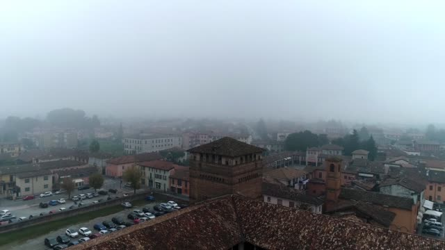 Medieval castle in Italy during a foggy day