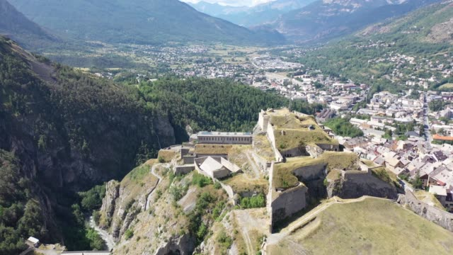 medieval citadel on hilltop on background with french fortified township of briancon - hautes alpes stock videos & royalty-free footage
