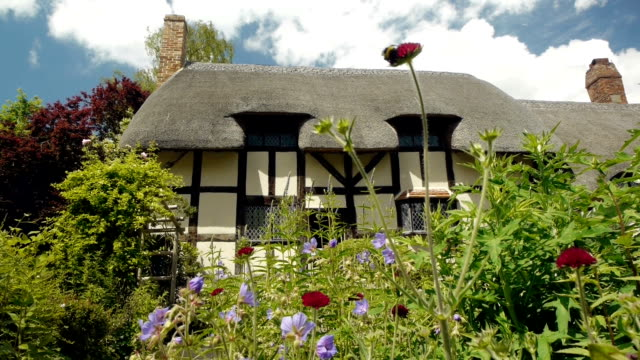 Medieval half-timbered English cottage seen from the garden.