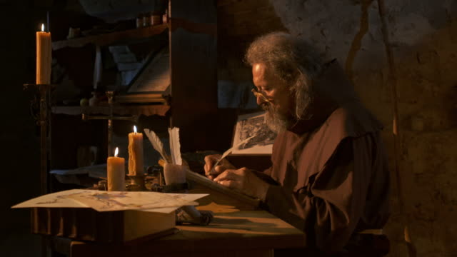 HD: Medieval Scribe Writing By Candlelight video