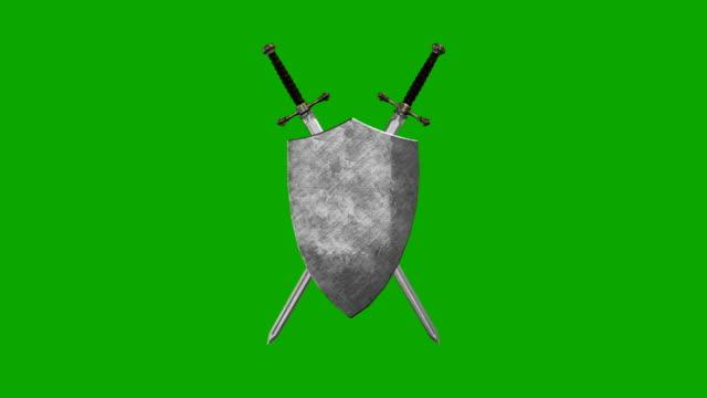 vídeos y material grabado en eventos de stock de espada medieval y el escudo formando un símbolo sobre un fondo de pantalla verde - shield