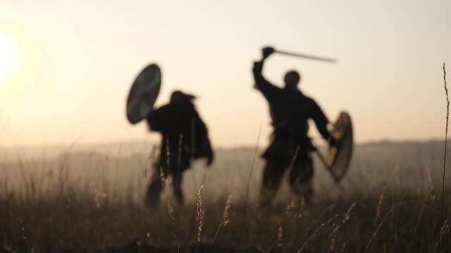 Medieval warriors fighting at dusk