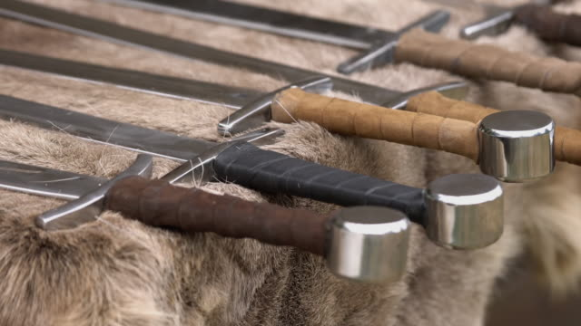 Medieval weapons replicas for close combat used in wars on display on animal fur
