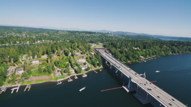 Medina Washington - Aerial Flying Over Highway 520 Bridge as Traffic Crosses From Seattle to Bellevue