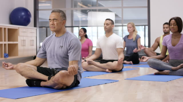 Meditating in Lotus Position in Fitness Class video