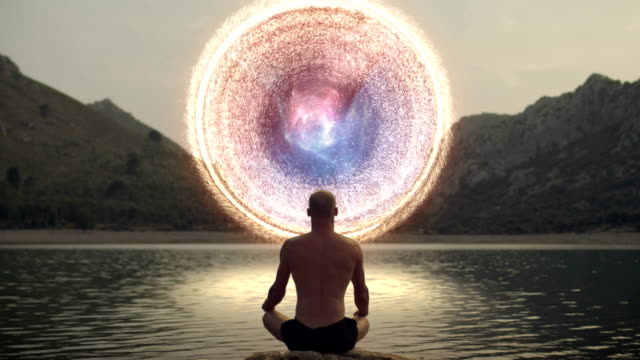 Meditating man opening gate to cosmic energy Spiritual Awareness. Man opening portal to other worlds. zen like stock videos & royalty-free footage