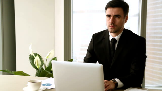 meditation at work. busy young businessman taking break to meditate - mindfulness stock videos & royalty-free footage