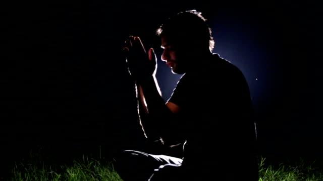 Meditation silhouette of man at night video