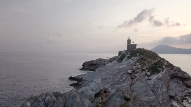 Mediterranean Sea Rock Lighthouse Morning Aerial View - video