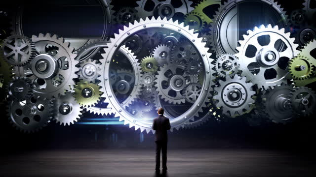 medium businessman standing big gear wheels, connecting gear wheels. - financial planning stock videos and b-roll footage