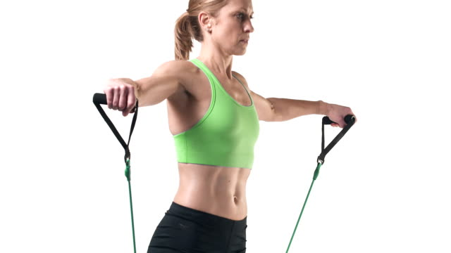Medium shot of a female doing exercise with a resistance band Medium shot of a female doing exercise with a resistance band human joint stock videos & royalty-free footage