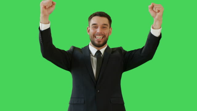 Medium Shot of a Handsome Businessman Making Win Gestures and Rejoycing. Celebrating His Success. Background is Green Screen. video