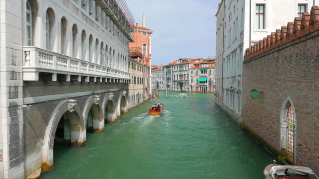 Medium shot of boat along Venetian canal. video