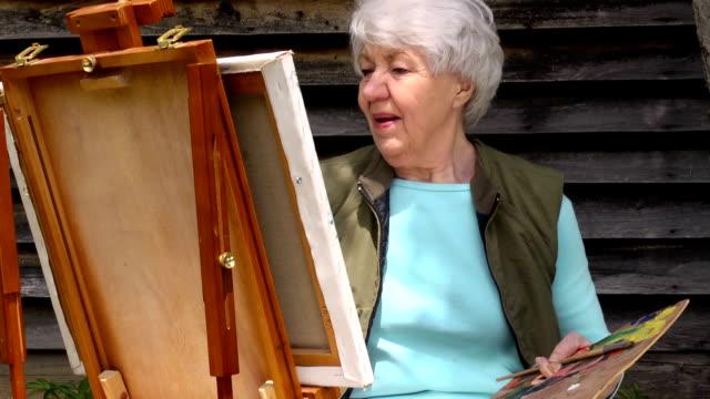Medium Shot of Senior Woman Painting video