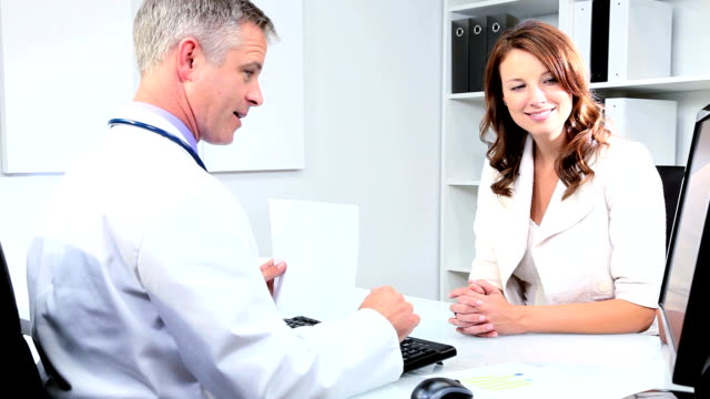 Meeting Doctor and Pharmaceutical Representative Female pharmaceutical saleswoman meeting male Caucasian doctor in his office  saleswoman stock videos & royalty-free footage