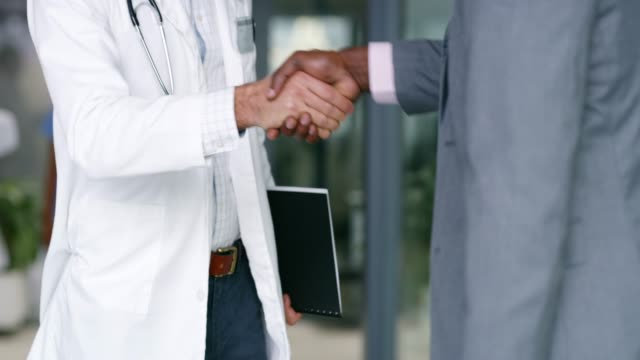 Meeting with a pharmaceutical rep to discuss new advancements