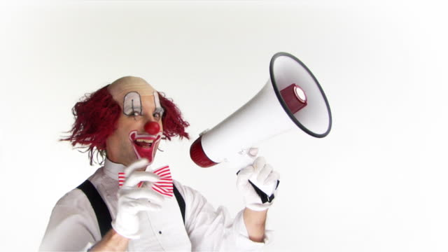Mega Clown .. Clown with a megaphone.Slow motion. dyed red hair stock videos & royalty-free footage