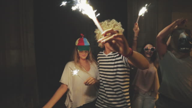 Megaparty: friends party wild in the streets Megaparty: friends party wild in the streets, with fireworks and confetti mask disguise stock videos & royalty-free footage
