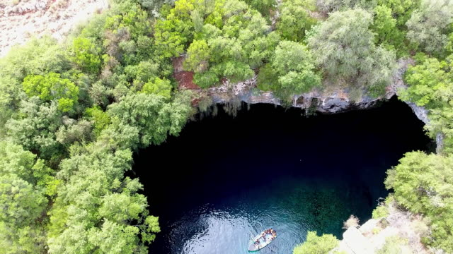 Melissani Cave - Kefalonia Melissani Cave aerial view. Kefalonia quadcopter stock videos & royalty-free footage