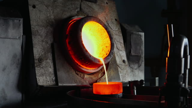Melting gold in the gold foundry Foundry Worker in protective clothing metalwork stock videos & royalty-free footage