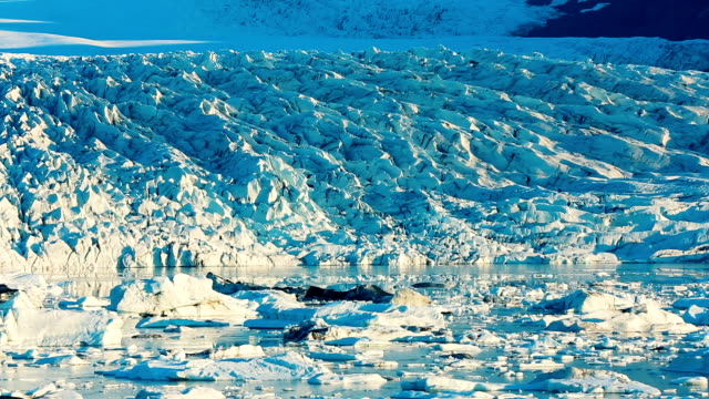 Melting Ice Slow Pan of Melting Glacier in Iceland on a sunny blue sky day icecap stock videos & royalty-free footage