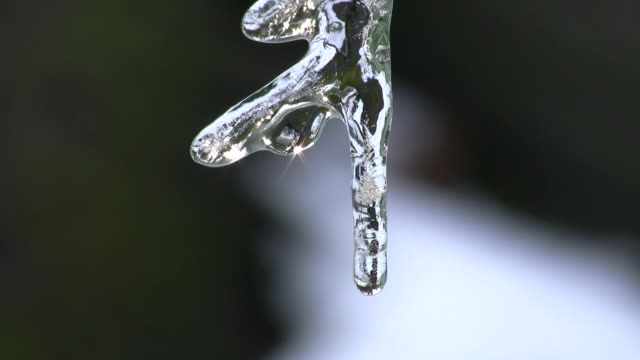 Melting icicle close up video
