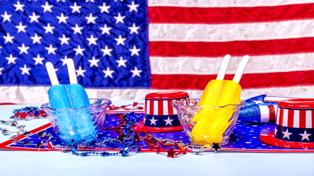 Melting popsicles on patriotic background video