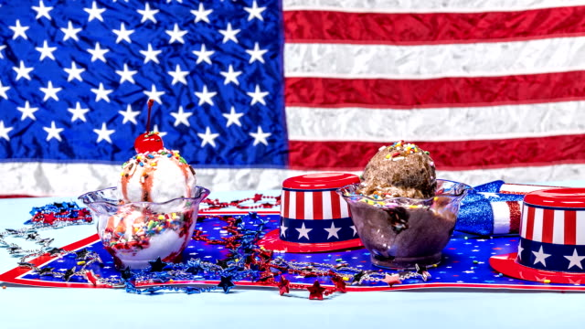melting vanilla and chocolate ice cream patriotic background - memorial day стоковые видео и кадры b-roll