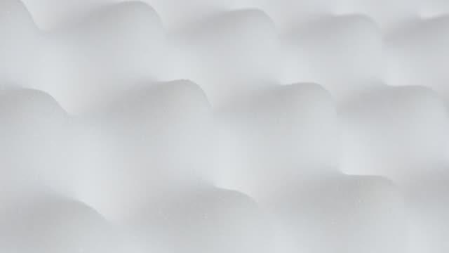 memory foam topper with peak and valley form close-up 4k - poliuretano polimero video stock e b–roll