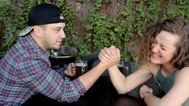 Men and woman friendship  arm wrestling,Woman winning video