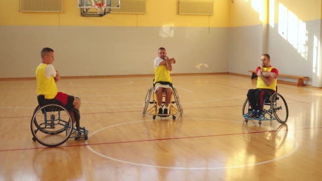Men are stretching in the wheelchair