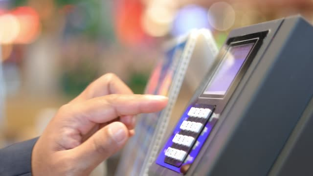 vídeos de stock e filmes b-roll de men are using credit cards on the store cashier - paying with card contactless