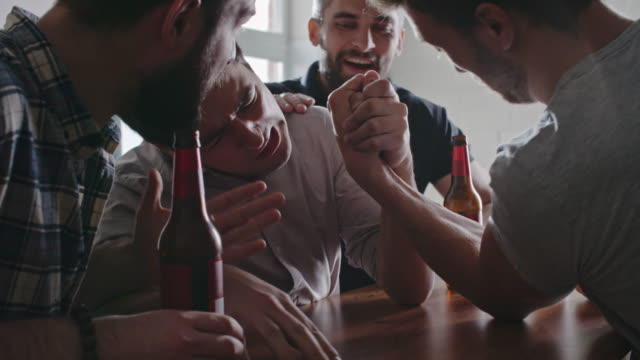 Men Arm Wrestling at Party video