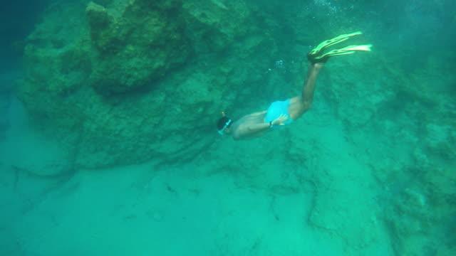 Men diving undersea video