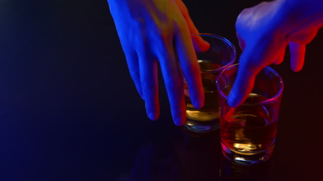 men drinking whiskey, close up of glasses and hands - whisky video stock e b–roll