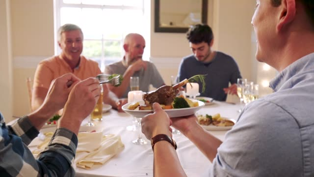 Men Eating At A Dinner Party video