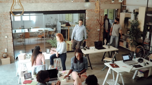 men entering office and greeting other colleagues - поколение z стоковые видео и кадры b-roll